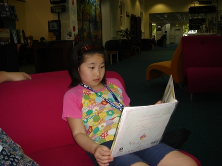 Karen reading in library.JPG